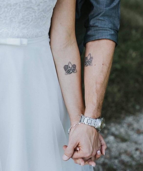 tattoo matrimoniale uguale su braccio